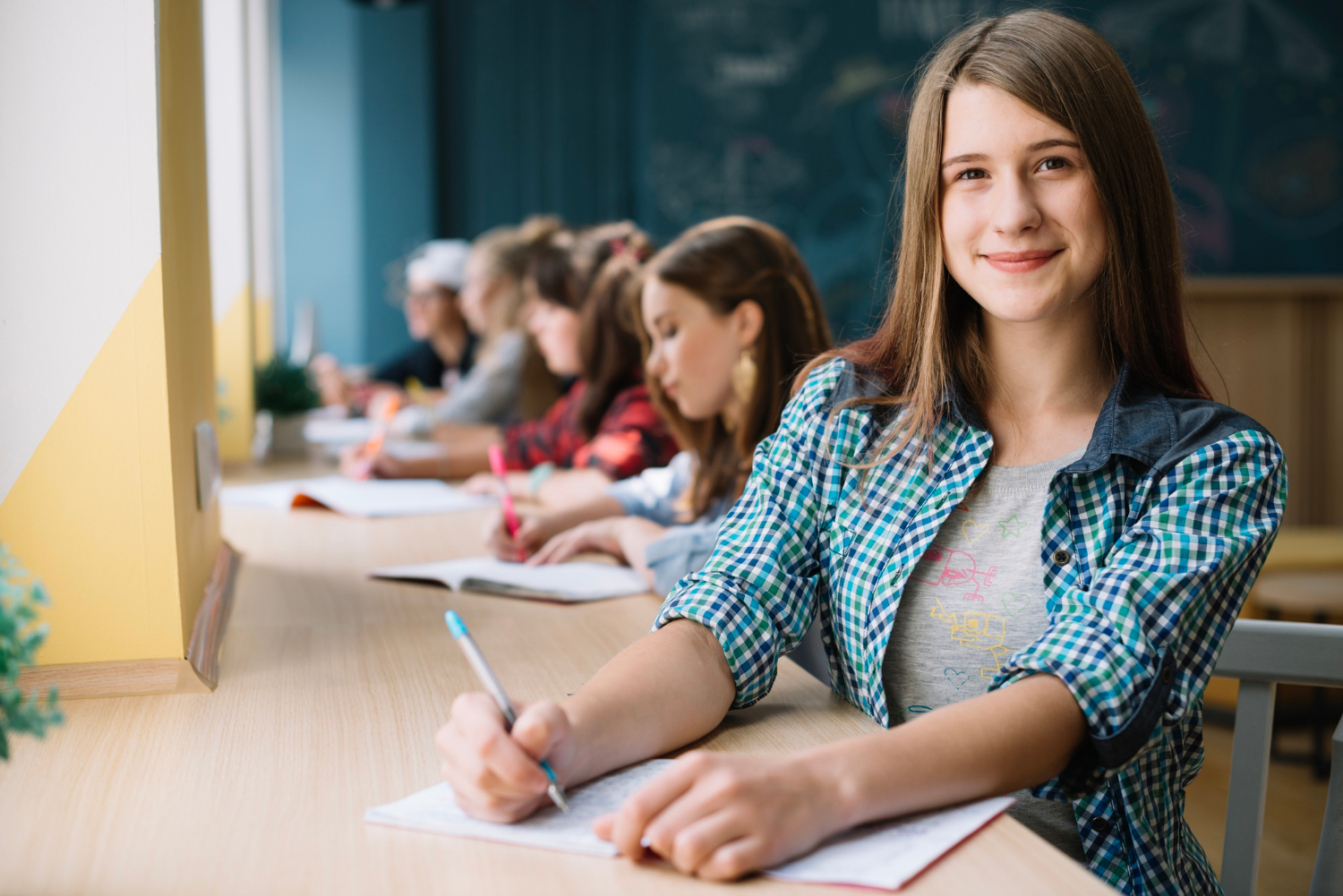 cheerful-teen-girl-student-with-classmates